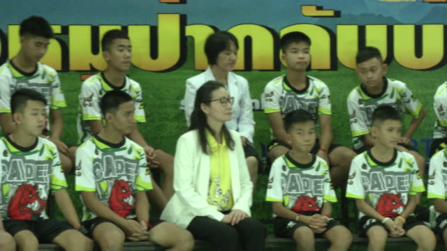 the tham luang boys speak at a press conference in chaing rai after being released from the hospital. divers evacuated the 13 boys trapped in a... - football team stock videos & royalty-free footage