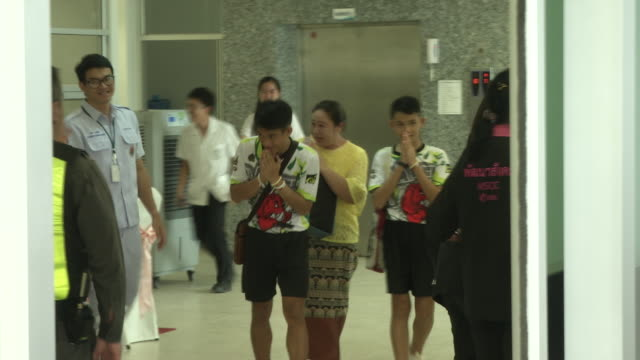 the tham luang boys walk out of prachanukroh hospital in chaing rai after recuperating for about a week after rescue divers evacuated the 13 boys... - teenage boys stock videos & royalty-free footage