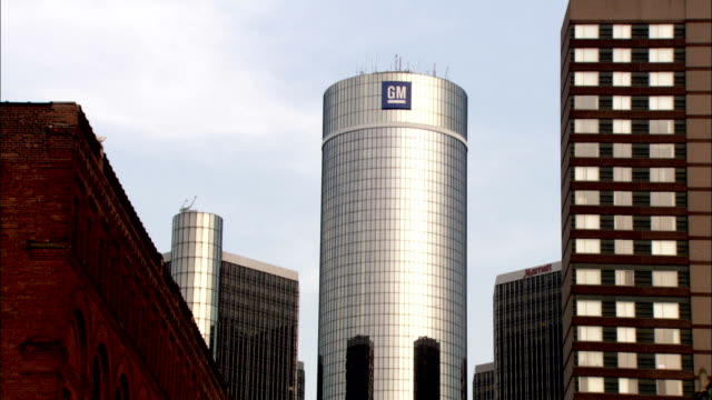 the the general motors headquarters stands next to the marriot at the renaissance center. available in hd. - general motors stock videos & royalty-free footage