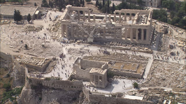 the theater of dionysus amphitheater ruins lie at the foot of the acropolis. - amphitheatre stock videos & royalty-free footage