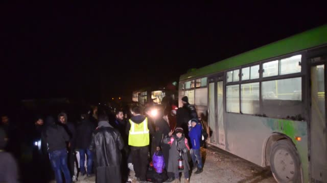 the third convoy of civilians fled from east aleppo that had been under siege by iranled shiite militias and assad regime forces has reached an... - belagerung stock-videos und b-roll-filmmaterial