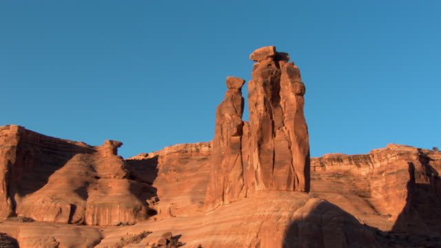 The Three Gossips rock formation towers above Arches National Park, Utah.