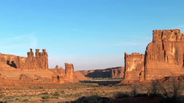 The Three Gossips rock formation towers aobve Arches National Park, Utah.