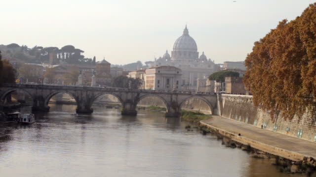 the tiber river with  view of ponte sant'angelo - naga river stock videos and b-roll footage
