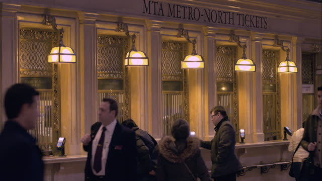 the ticket windows in the main concourse of grand central terminal in manhattan - western script stock videos & royalty-free footage