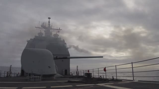 the ticonderoga-class guided-missile cruiser uss lake champlain fires its forward mk 45 5-inch gun during a live fire event. lake champlain is... - anti aircraft stock videos & royalty-free footage