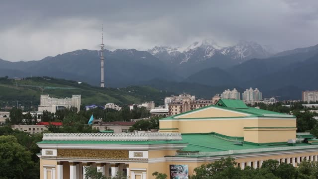 vídeos de stock, filmes e b-roll de the tien shan mountains sit beyond the opera house in almaty kazakhstan on monday june 22 2015 shots almaty television tower in front of the... - ritz carlton hotel