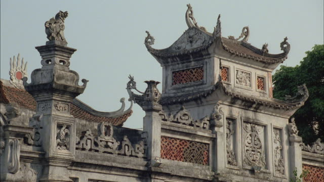 the tiered eaves on a vietnamese pagoda point upward. - eaves stock videos and b-roll footage