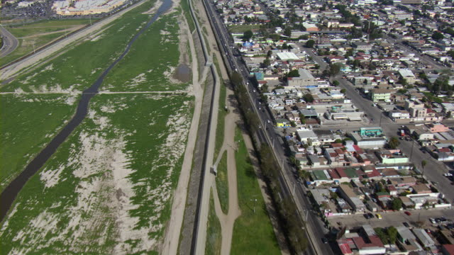 the tijuana river runs along the border between mexico and the united states. - tijuana stock videos & royalty-free footage