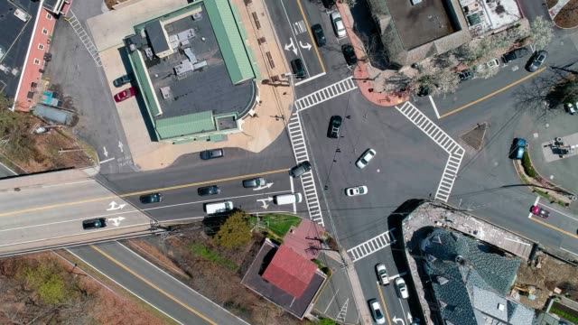 the time-lapse aerial drone video of the traffic at the intersection in scarsdale, westchester county, new york state, usa - small town stock videos and b-roll footage