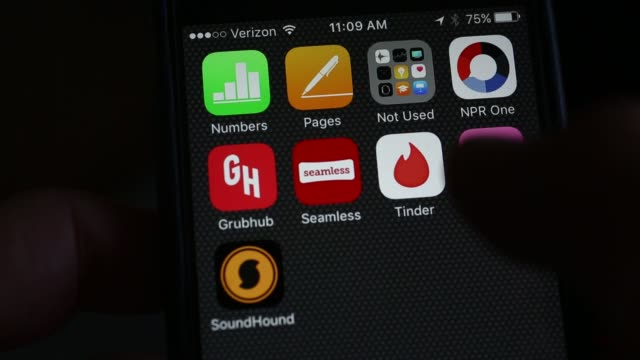 The Tinder application is displayed in the Apple Inc App Store on a laptop computer and iPhone in Washington DC US on Monday Feb 6 2017 Shots CU...