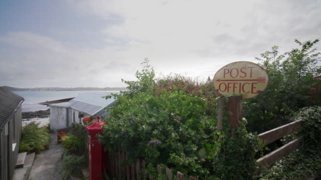 the tiny village post office on the beach in the village baile mòr, iona, scotland. - pilgrimage stock videos & royalty-free footage