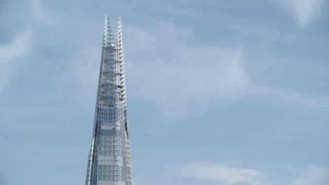 the tip of the shard / london, united kingdom - shard london bridge stock videos & royalty-free footage