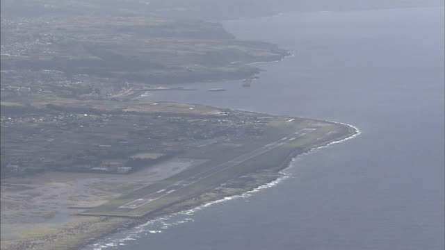 The  Tokunoshima Airport runway stretches along the coast of  Tokunoshima Island, Japan.