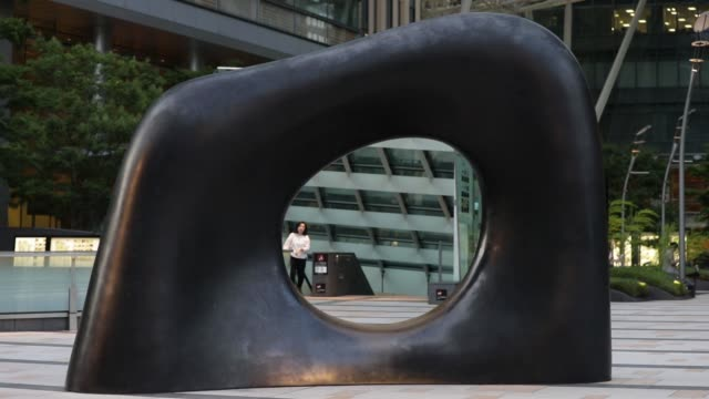 the tokyo midtown complex stands in the roppongi district of tokyo, japan, on tuesday, june 6 a scculpture stands in the tokyo midtown complex in the... - tokyo midtown stock videos & royalty-free footage