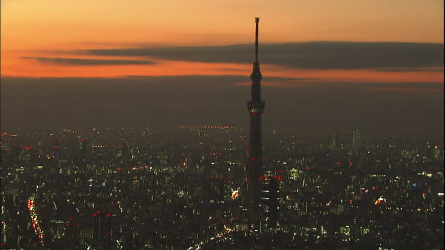 The Tokyo Skytree towers over the city of Tokyo at night in Japan.