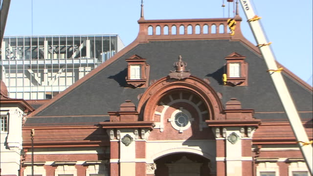 the tokyo station marunouchi building restored to their original 1914 design roof of the central part of the station building zooming in on the roof... - slate rock stock videos and b-roll footage