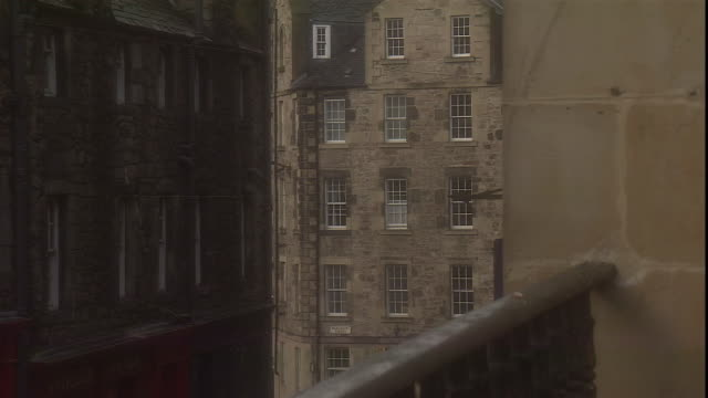 the tolbooth church towers over rooftops in edinburgh, scotland. - pinnacle stock videos & royalty-free footage