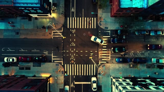 the top directly above night view of the intersection in the city - brooklyn, new york - pedestrian crossing stock videos & royalty-free footage