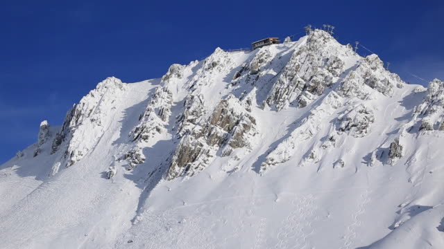 The top of a snow covered mountain.