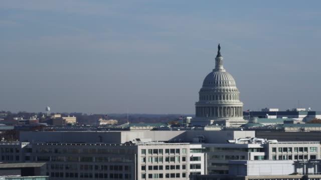 vídeos y material grabado en eventos de stock de the top of the capitol building with southwest district office buildings in foreground, washington dc. shot in 2011. - artbeats