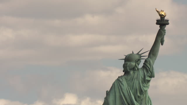 the top third of the statue of liberty including her tunic, crown and torch taken from her back. - tunic stock videos & royalty-free footage