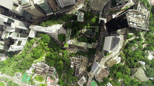 the top view of the building tower in green hong kong city - futuristico video stock e b–roll
