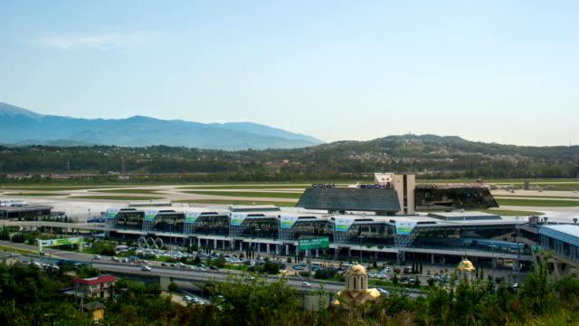 vídeos y material grabado en eventos de stock de tl the top view of the sochi international airport  / russia, sochi - sochi
