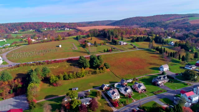 the top view on the road in the small town kunckletown, poconos, pennsylvania, with fall foliage. aerial drone video. - scena rurale video stock e b–roll