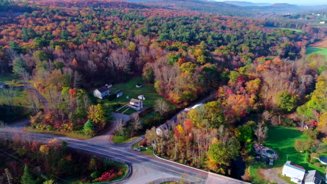 the top view on the road in the small town kunckletown, poconos, pennsylvania, with fall foliage. aerial drone video. - remote location stock videos & royalty-free footage