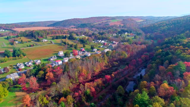 the top view on the road in the small town kunckletown, poconos, pennsylvania, with fall foliage. aerial drone video. - appalachia stock videos & royalty-free footage
