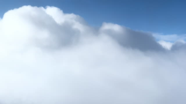 the tops of clouds while flying through them (view from aircraft) - cumulonimbus stock videos & royalty-free footage