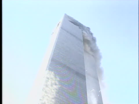 the tops of the twin towers smoke on 9 11. - manhattan stock videos & royalty-free footage