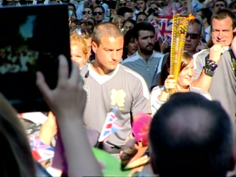 the torch also made a quick stop in downing street it was carried by kate nesbitt the first woman in the royal navy to be awarded the military cross... - olympic torch stock videos & royalty-free footage