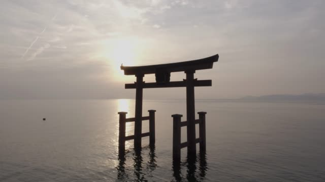 the torii gate of shirahige-jinja shrine(famous place for sunrise) floating in biwa lake, takashima, shiga prefecture, japan - shiga prefecture stock videos & royalty-free footage