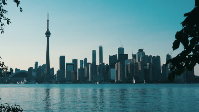 stockvideo's en b-roll-footage met the toronto city skyline during the afternoon hours on august 9 in ontario, canada, united states of america. - ontariomeer