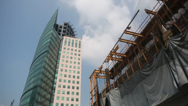 the torre mayor building left stands next to the torre reforma office tower under construction in mexico city mexico construction continues on the... - mayor stock videos & royalty-free footage