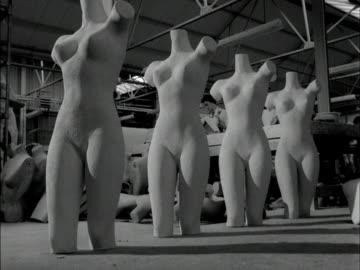 the torso of a female mannequin is picked up in a factory workshop. 1959. - torso bildbanksvideor och videomaterial från bakom kulisserna