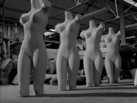 the torso of a female mannequin is picked up in a factory workshop. 1959. - torso video stock e b–roll