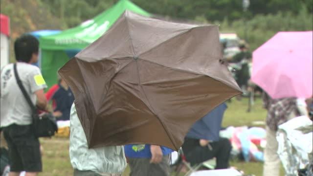 the total solar eclipse/ akusekijima isl./ kagoshima prefecture - umbrella stock videos and b-roll footage