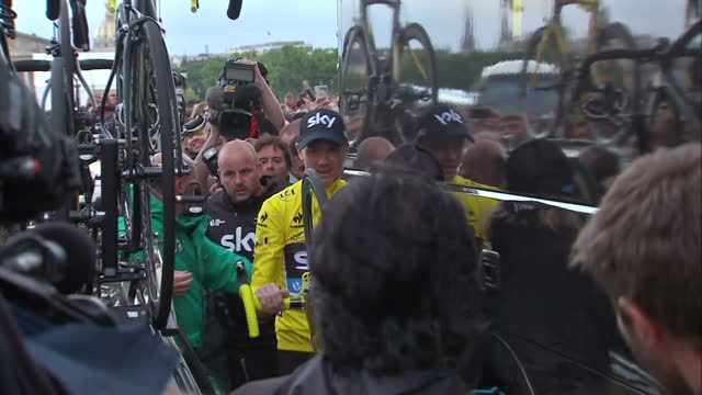 The Tour de France to finish in Paris with Chris Froome wearing the yellow jersey Shows exterior shots Chris Froome arriving back at the Team Sky bus...