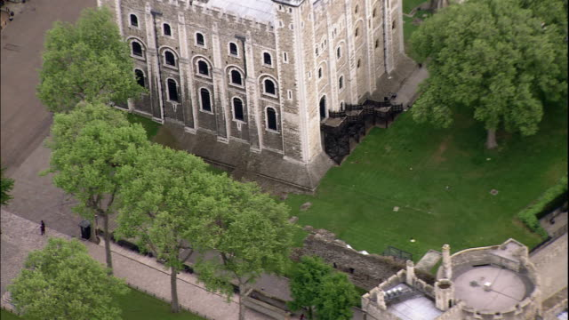 the tower of london rises above a pristine park in london, england. - tower of london stock videos & royalty-free footage