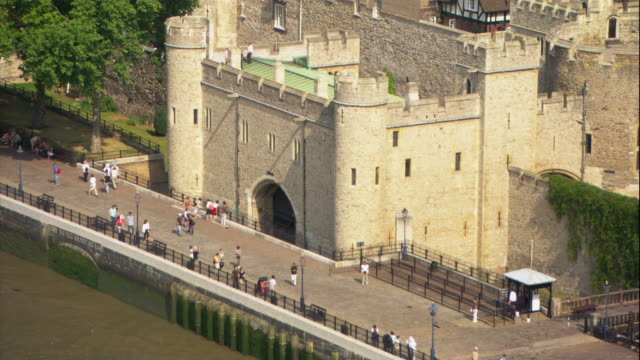 the tower of london sits in a forested area of the city. - tower of london stock videos & royalty-free footage