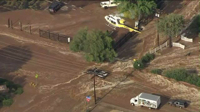 KTLA The town of Acton was hit by a sudden flash flood brought on by unseasonal monsoonal weather that left vehicles stranded in the street and...