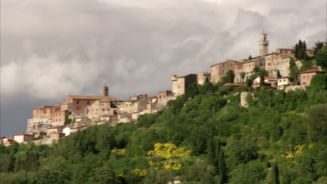 the town of montepulciano sits on a hillside above the san biagio church. available in hd. - tuscany stock videos & royalty-free footage