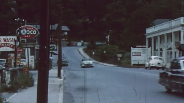 the town of roslyn new york on the north shore of long island home movie filmed in 1956 16mm - scratched stock videos & royalty-free footage