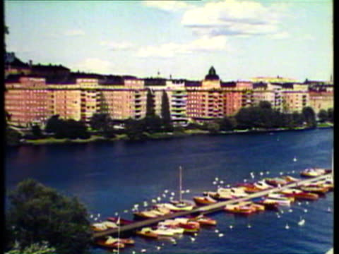 1953 ws pan the town of stockholm, tiny sailboat / stockholm, sweden / audio - 1950 stock videos & royalty-free footage