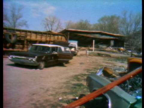 the town of wounded knee, south dakota, lies in ruins after the american indian movement take-over and ensuing government siege. - 1973 stock-videos und b-roll-filmmaterial