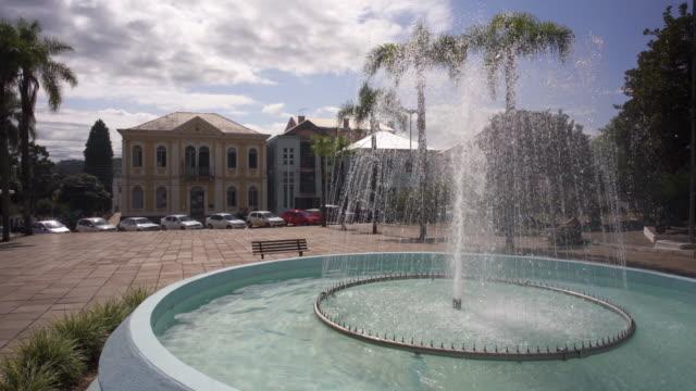 the town square and fountain in antônio prado, southern brazil. - stato di rio grande do sul video stock e b–roll