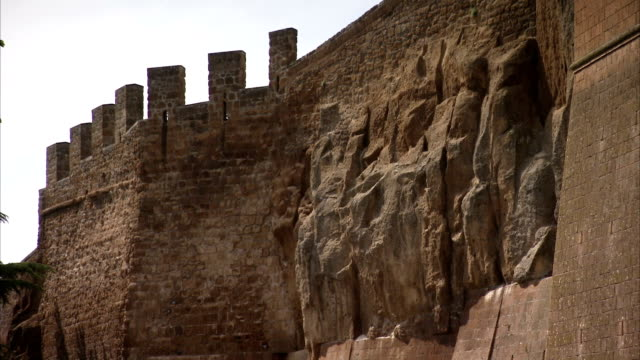 the town wall of orvieto features crenelations. available in hd. - castle wall stock videos and b-roll footage